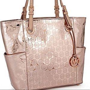 4709619899f9 Women Michael Kors Mirror Metallic Handbag on Poshmark